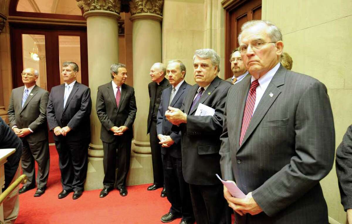 From left, U.S Rep. Paul Tonko, state Sen. Neil Breslin, Assemblyman Ron Canestrari, Albany Bishop Howard Hubbard, Assemblyman Bob Reilly, Assemblyman John McEneny and Albany County Executive Mike Breslin at swearing-in ceremonies Wednesday, Dec. 29, 2010, in the Assembly chambers at the Capitol. (Skip Dickstein / Times Union)