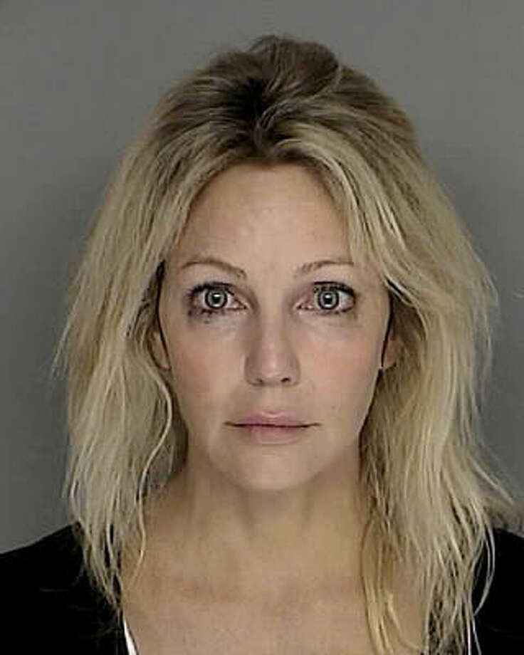 Heather LocklearArrestedLocklear was arrested after police say she was cited for hitting a no-parking sign on a public street and fleeing the scene. Locklear was still on probation after having had a previous run-in with the law back in 2008 on a DUI arrest. (Associated Press)