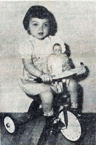 """The little girl with the Buster Brown haircut won the jackpot of prizes as Beaumont's first baby of 1948. She is Peggy Carol Angele, daughter of Mr. and Mrs. S..C. Angele."" Enterprise file photo from Dec. 31, 1949"