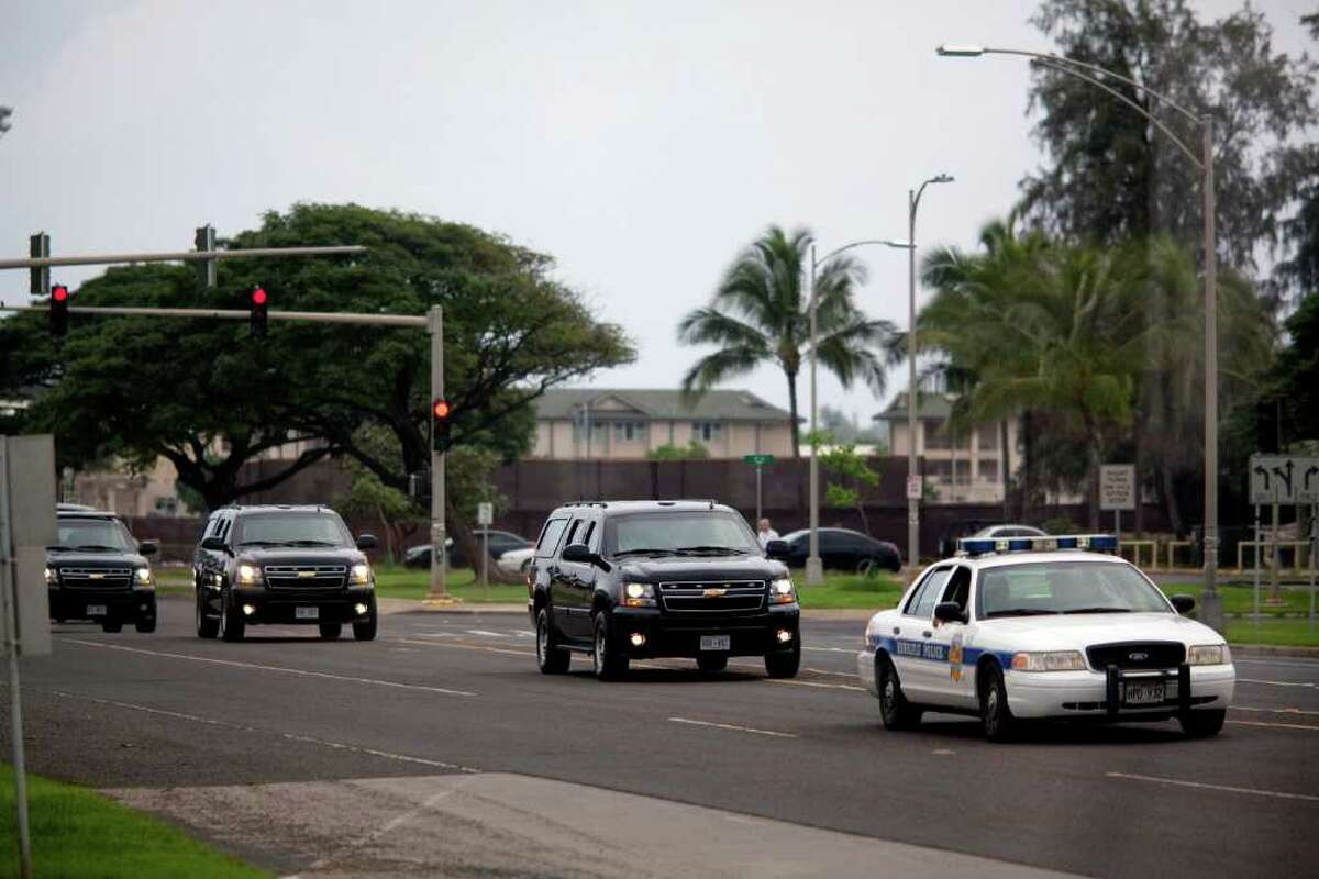 KAILUA, HI - DECEMBER 29: (AFP OUT) President Barack Obama's Motorcade is seen departing Marine Corps Base Hawaii after his routine morning workout at Semper Fit gym December 29, 2010 in Kailua, Hawaii. The Obama's are on an 11-day family vacation in Hawaii. (Photo by Kent Nishimura-Pool/Getty Images)