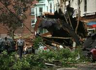A building's roof crashed down upon cars and storefronts at 420 East Main Street in Bridgeport during a violent afternoon thunderstorm, Thursday, June 24, 2010.