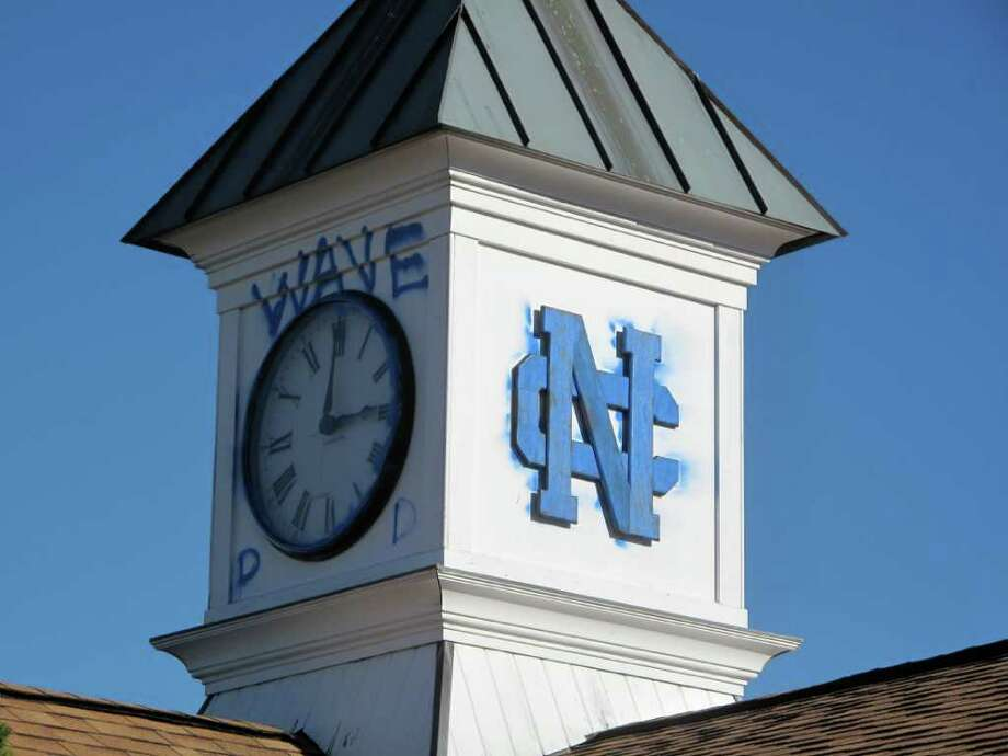 Clock tower at Dunning Field painted blue by Darien football players Photo: Contributed Photo / New Canaan News