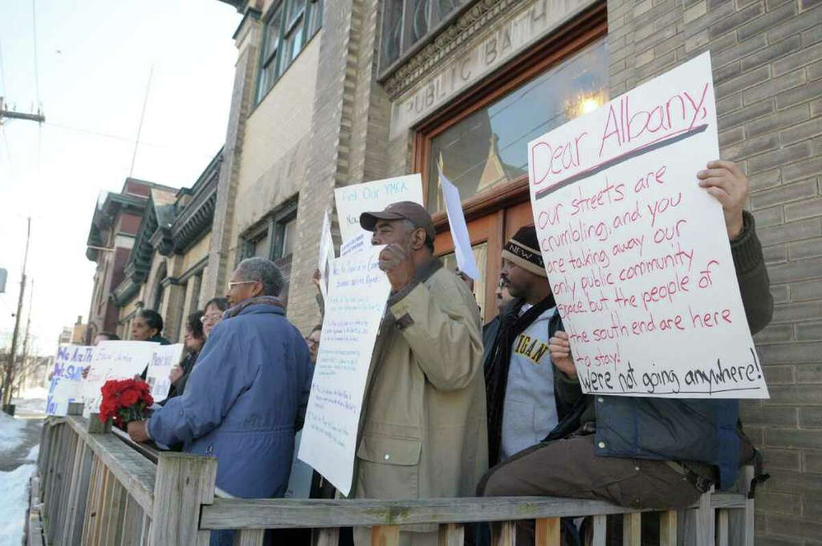 Supporters of Albany's Public Bath No. 2 rally at the building on Thursday, protesting its closing. (Paul Buckowski / Times Union)