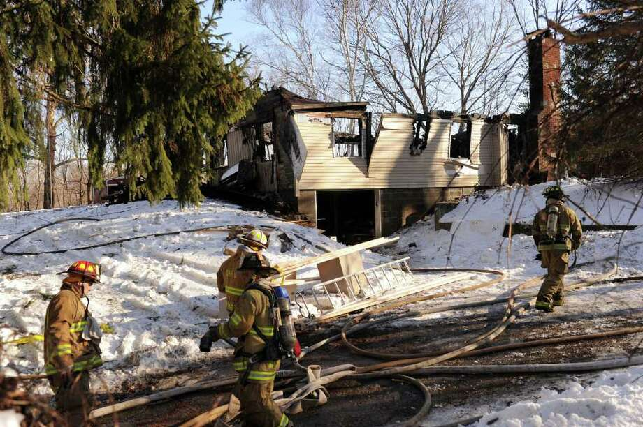 A home on Elbow Hill Road in Brookfield that was under renovation was destroyed by fire Thursday afternoon, Dec. 30, 2010. Photo: Carol Kaliff / The News-Times