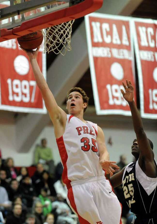 Fairfield Prep's #35 Nick Hoin takes the ball up for two points as Notre Dame of Fairfield's #25 Kevin Lang defends, during the Fairfield Prep Holiday Classic boys basketball tournament at Alumni Hall at Fairfield University in Fairfield, Conn. on Thursday December 30, 2010. Photo: Christian Abraham / Connecticut Post