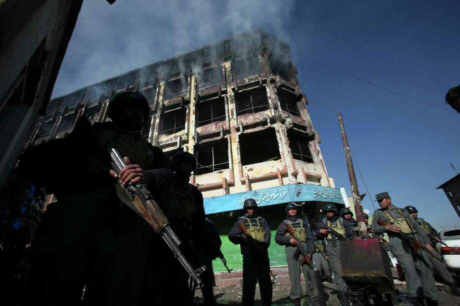 Afghan police stand guard outside the Feroshgah-e-Afghan Shopping Center in Kabul, Afghanistan, Jan. 18, 2010, after a Taliban suicide bomber blew himself up inside. Photo: EDWARD A. ORNELAS, SAN ANTONIO EXPRESS-NEWS / eaornelas@express-news.net