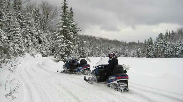 Snowmobilers are praising state payment of $30 million for a convervation easement on 89,000 acres in the central Adirondacks that will add new connector trails between North Country towns. It is expected to boost tourism spending in the North Country. (Photo courtesy NYS Snowmobilers' Association)