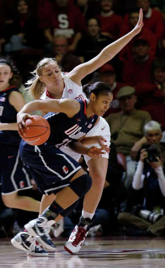Connecticut forward Maya Moore (23) works against Stanford forward Joslyn Tinkle in the first half of an NCAA college basketball game in Stanford, Calif., Thursday, Dec. 30, 2010. (AP Photo/Paul Sakuma) Photo: AP