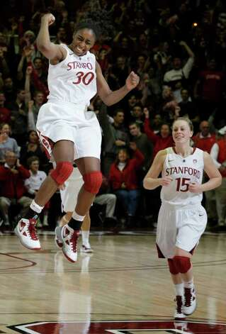 Stanford forward Nnemkadi Ogwumike (30) celebrates with guard Lindy La Rocque (15) after an NCAA college basketball game in Stanford, Calif., Thursday, Dec. 30, 2010. Stanford upset Connecticut 71-59, ending Connecticut's winning streak at 90 games. (AP Photo/Paul Sakuma) Photo: AP