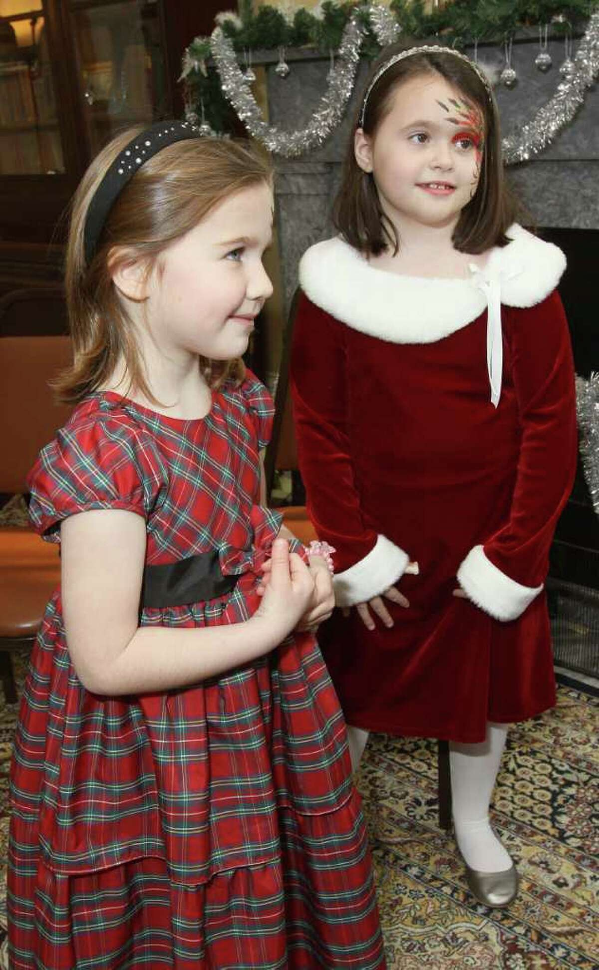 Ashley Pittman, left, and Kara Foley wait patiently to talk to Santa. (Joe Putrock / Special to the Times Union)