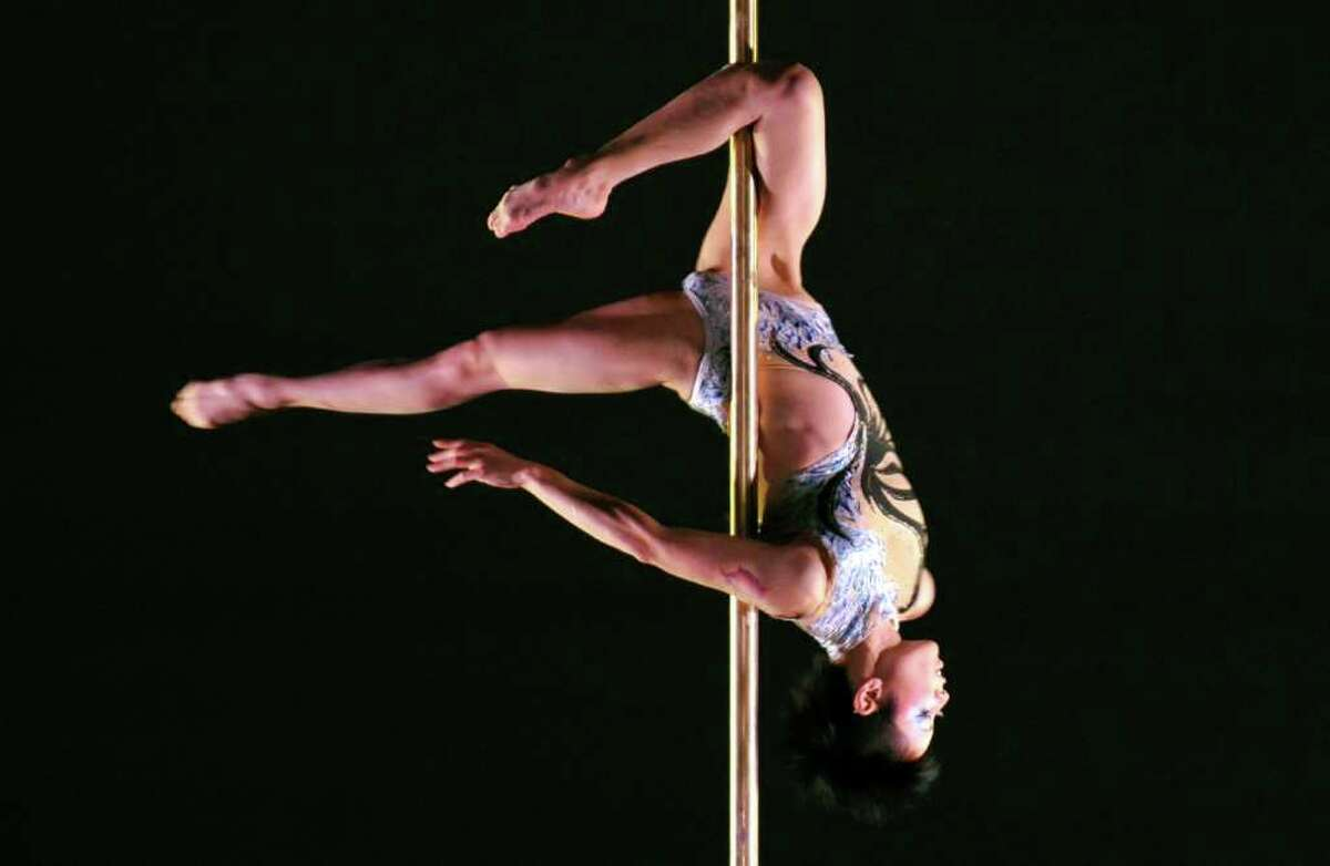 Mai Sato of Japan performs during the women's division grand final competition of the International Pole Championship in Tokyo on December 9, 2010. Pole-dancing may have started in the smoky backrooms of adult-only bars -- but now performers have lifted the velvet curtain on what they say is a sensual art form and a great workout. AFP PHOTO / KAZUHIRO NOGI