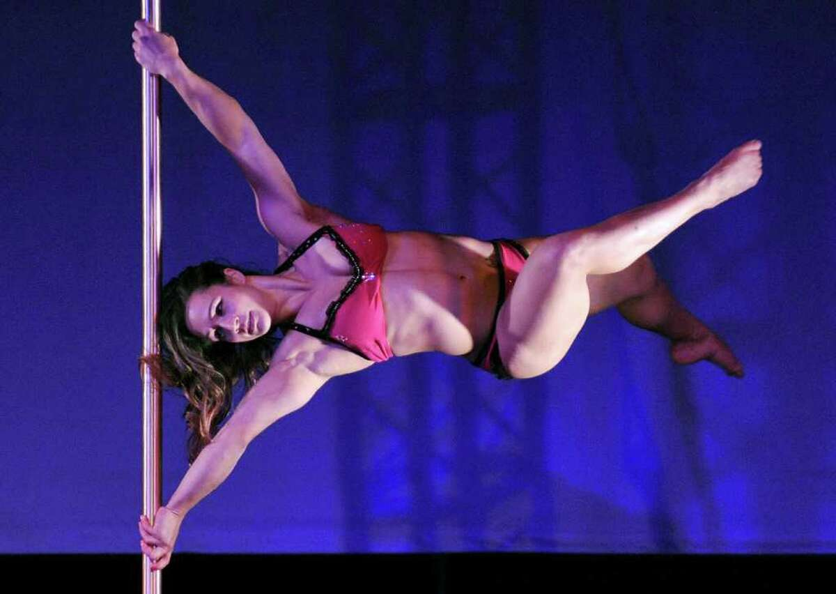 Rafaella Montanaro of Brazil performs during the women's division grand final competition of the International Pole Championship in Tokyo on December 9, 2010. Pole-dancing may have started in the smoky backrooms of adult-only bars -- but now performers have lifted the velvet curtain on what they say is a sensual art form and a great workout. AFP PHOTO / KAZUHIRO NOGI