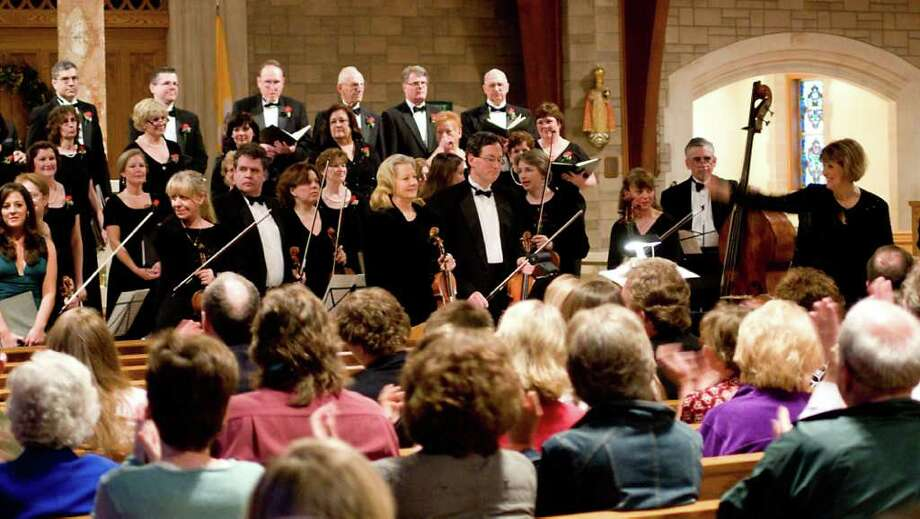 "The Connecticut Chamber Choir's post-holiday concert, ""Laudate,"" takes place Sunday, Jan. 9 at Saint Theresa Roman Catholic Church in Trumbull, under the direction of Constance Chase, far right. Photo: CONTRIBUTED PHOTO"