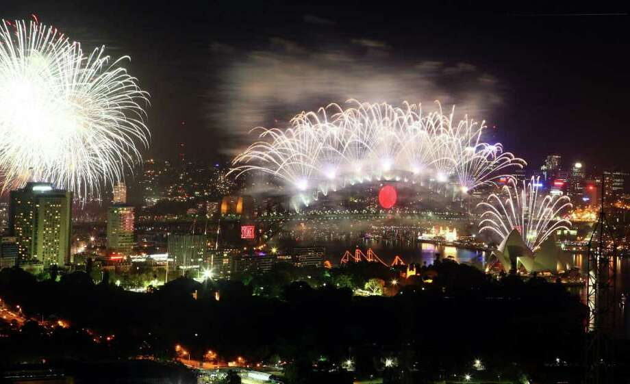 SYDNEY, AUSTRALIA - DECEMBER 31:  Fireworks light up Sydney Harbour at the stroke of midnight to welcome in the year 2011  on December 31, 2010 in Sydney, Australia.  (Photo by Don Arnold/Getty Images) Photo: Don Arnold