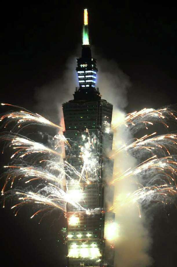 Fireworks explode above Taiwan's tallest building, Taipei 101, on January 1, 2011 to celebrate the New Year. Hundreds of thousands of people gathered in Taipei to mark the 100th anniversary of the establishment of the Republic of China.  AFP PHOTO / PATRICK LIN (Photo credit should read PATRICK LIN/AFP/Getty Images) Photo: PATRICK LIN