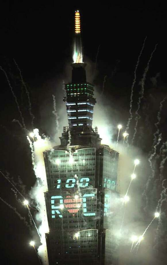 Fireworks forming the number 100 are seen above Taiwan's tallest building, Taipei 101, on January 1, 2011 to celebrate the New Year. Hundreds of thousands of people gathered in Taipei to mark the 100th anniversary of the establishment of the Republic of China. AFP PHOTO/PATRICK LIN (Photo credit should read PATRICK LIN/AFP/Getty Images) Photo: PATRICK LIN