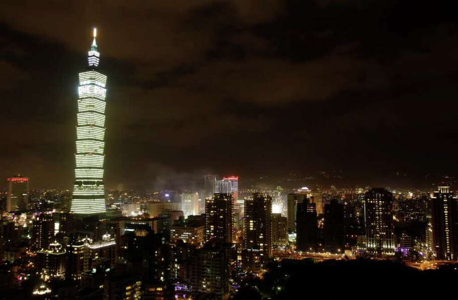 Taipei glows around Taiwan's tallest skyscraper Taipei101 with lights and fireworks to usher in the