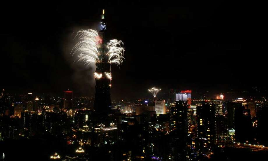 A firework display explodes off Taiwan's tallest skyscraper Taipei101 to usher in the New Year, Saturday, Jan. 1, 2011 in Taipei, Taiwan. 2011 marks the 100th anniversary of the Chinese revolution which toppled the last dynasty to establish China's first republic. The Republic of China is still Taiwan's official name. (AP Photo/Wally Santana) Photo: Wally Santana / AP