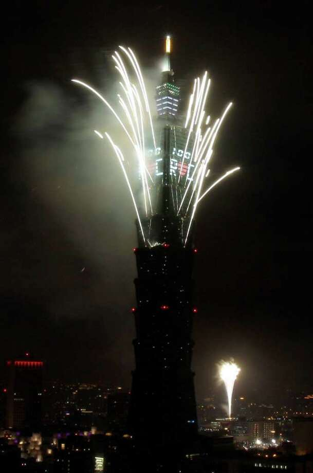 A massive firework display explodes off Taiwan's tallest skyscraper Taipei101 to usher in the New Year, Saturday, Jan. 1, 2011 in Taipei, Taiwan. 2011 marks the 100th anniversary of the Chinese revolution which toppled the last dynasty to establish China's first republic. The Republic of China is still Taiwan's official name. (AP Photo/Wally Santana) Photo: Wally Santana / AP