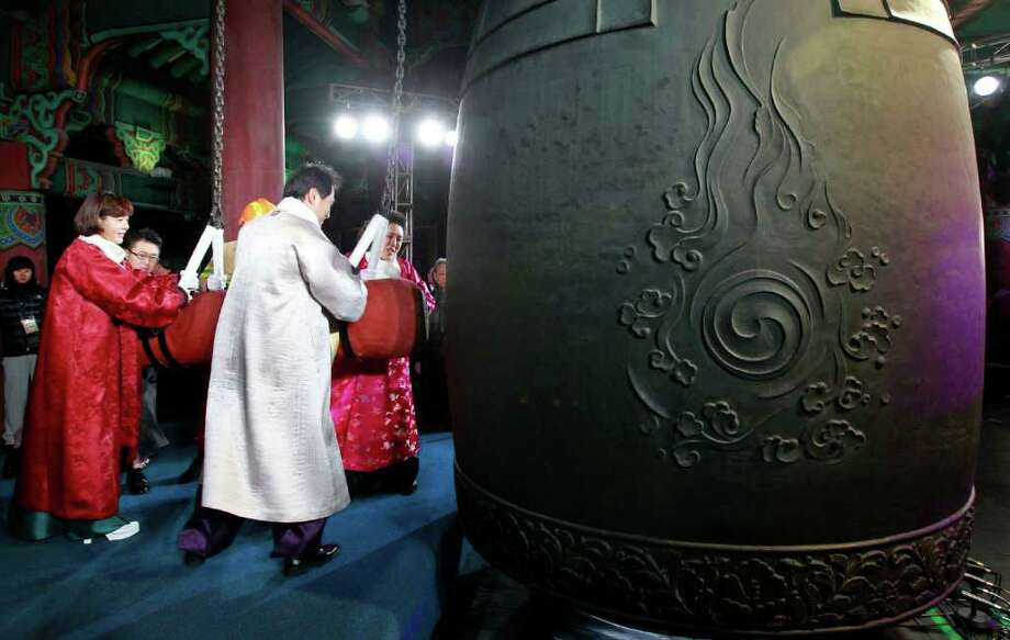South Korea's capital Seoul Mayor Oh Se-hoon, second from left, and participants hit a huge traditional bell to welcome the New Year at the Bosingak pavilion in Seoul, South Korea, Saturday, Jan. 1, 2011 (AP Photo/Jo Yong-Hak, Pool) Photo: Jo Yong-hak / REUTERS POOL