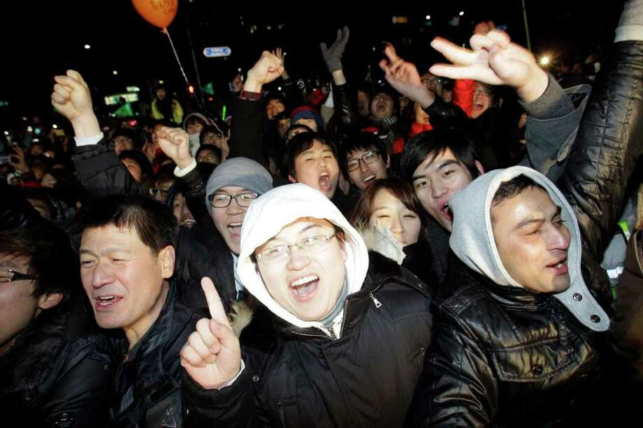 South Korean and tourists celebrate during New Year celebrations in Seoul, South Korea, Saturday, Jan. 1, 2011.  (AP Photo/ Lee Jin-man) Photo: Lee Jin-man / AP