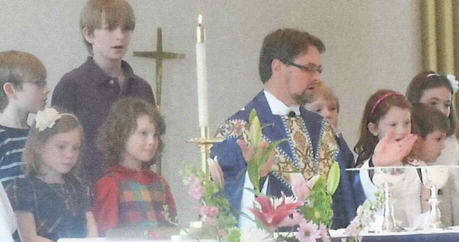 Rev. Matthew Calkins of St. Timothy's Episcopal Church in Fairfield with children of the congregation. Photo: Contributed Photo / Fairfield Citizen contributed