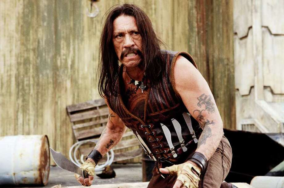 "Danny Trejo stars as a legendary ex-Federale in a scene from, ""Machete,"" a film that couldn't even live up (or is it down?) to its hype as a stupid-violent fun film.  (AP Photo/20th Century Fox, Joaquin Avellan) Photo: Joaquin Avellan / 20th Century Fox"