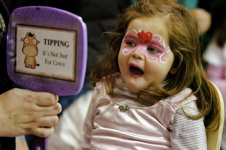 Sadie Katzner, 2, of Westport, reacts as she sees her face in the mirror, during First Night activities at the YMCA in downtown Westport, Conn. on Friday December 31, 2010. Photo: Christian Abraham / Connecticut Post