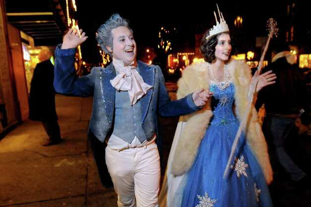 Joey Gugliemelli, 19, of Ballston Spa, left, portrays Jack Frost and Alex Vandenheever, 18, of Ballston Spa portrays the Snow Queen as they greet people on Broadway during First Night festivities on Friday, Dec. 31, 2010, in Saratoga Springs, N.Y. (Cindy Schultz / Times Union) Photo: Cindy Schultz