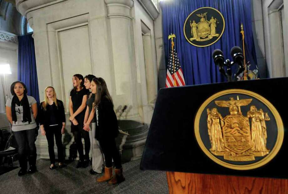 The Albanettes of Albany High practice Friday at the War Room in the Capitol for their New Year's performance at the swearing-in ceremony for Gov. Andrew Cuomo. The group includes Jasmin Rivera, left, Emily Thornton, Cante Yacobellis, Lillierose Ruby-Eck and Amal Hechehouche.( Michael P. Farrell/Times Union ) Photo: Michael P. Farrell