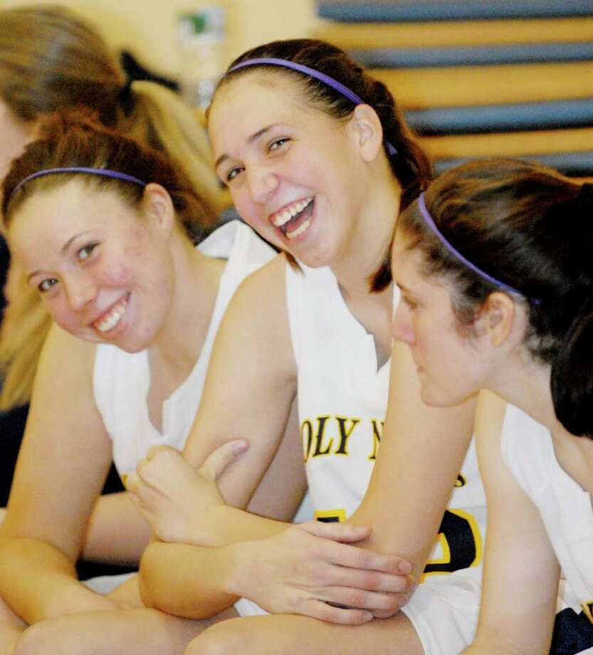 Sarah Agan of Holy Names celebrates with teammates after defeating Indian River High School on Tuesday, Dec. 28. Photo: Luanne M. Ferris