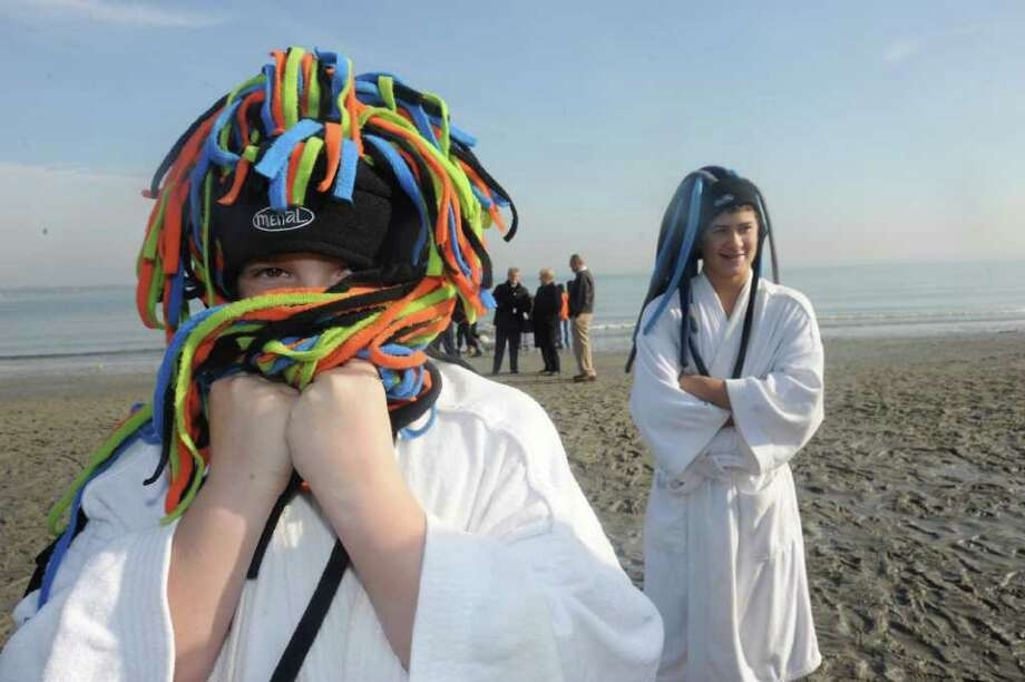 Robert Bray, 10, left, and his brother Eddie, of Greenwich, warm up after the Annual Polar Bear dip at Greenwich Point beach, on Saturday, Jan. 1, 2011. Photo: Helen Neafsey / Greenwich Time