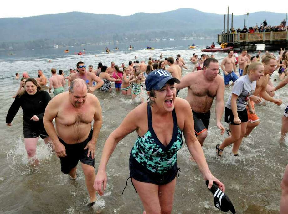 Brave swimmers run out of the cold water during Lake George Winter Carnival?s First Day Polar Plunge on Saturday, Jan. 1 in Lake George. (Cindy Schultz / Times Union Photo: Cindy Schultz