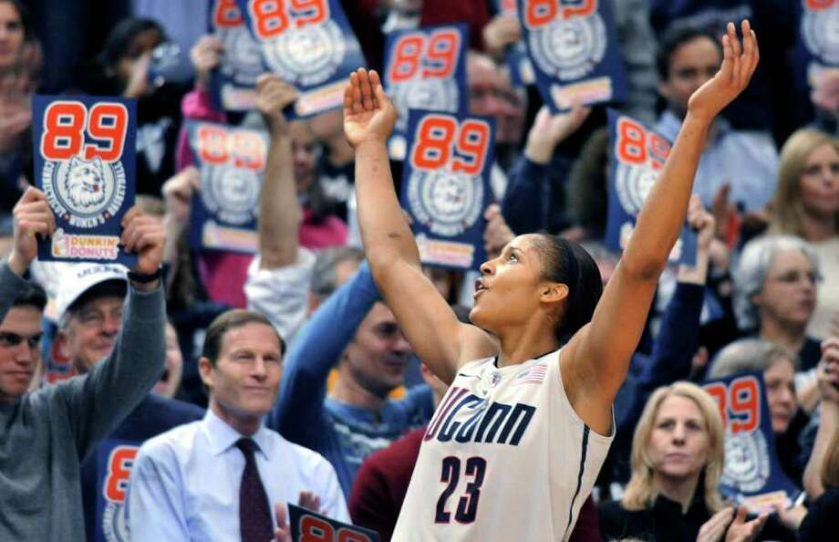 Connecticut forward Maya Moore celebrates near the end of an NCAA college basketball game against Florida State in Hartford, Conn., Tuesday, Dec. 21, 2010. Connecticut beat Florida State 93-62 to to set an NCAA record for consecutive wins, at 89. (AP Photo/Jessica Hill) Photo: AP