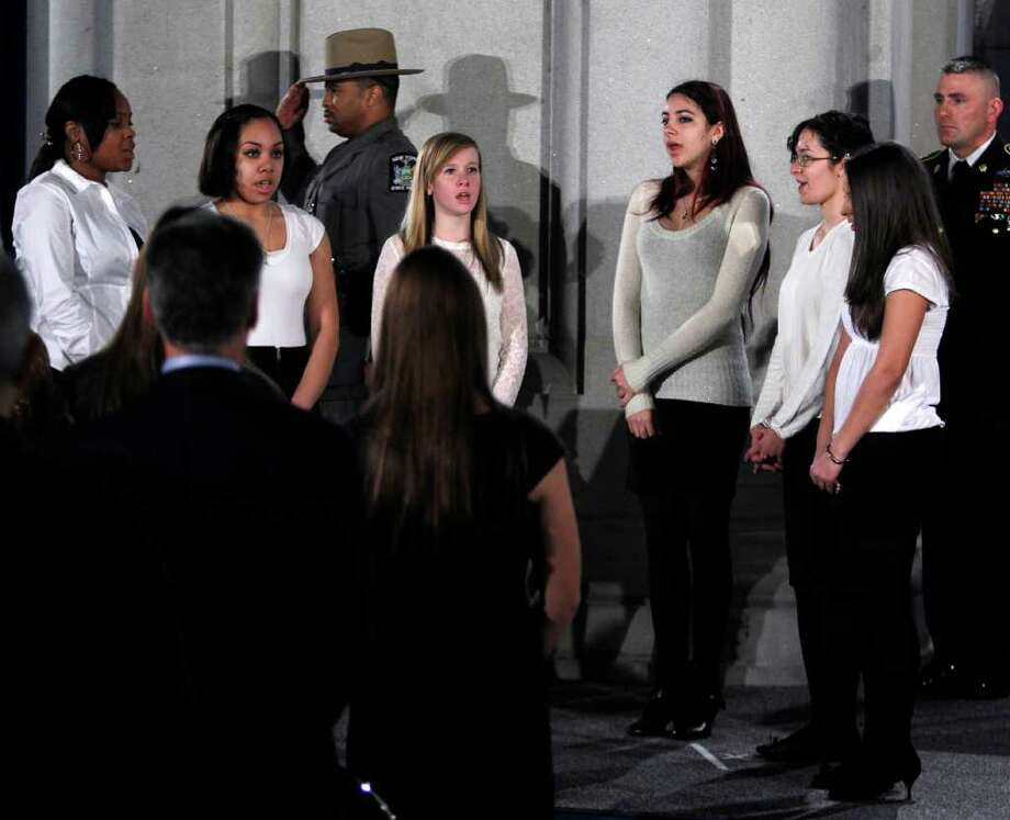 Members of the Albany High School Albanettes perform the national anthem during a Saturday swearing-in ceremony at the Capitol. The performers include Zora Middleton, left, Jasmine Rivera, Emily Thornton,  Cante Yacobellis, Lillierose Ruby-Eck and Amal Hechehouche. (Mike Groll/Times Union) Photo: Mike Groll