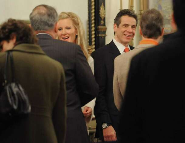 Albany County Executive Michael Breslin is greeted by Sandra Lee, left, while Gov. Andrew Cuomo welcomes another guest to the Executive Mansion in Albany on Saturday after a swearing-in at the Capitol. The new governor faces many challenges, including a $9 billion budget deficit. (Lori Van Buren/Times Union) Photo: Lori Van Buren