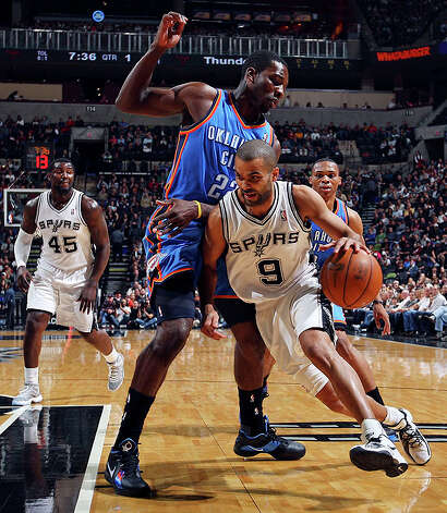 Spurs' Tony Parker looks for room around  Thunder's Jeff Green during first half action Saturday. Photo: EDWARD A. ORNELAS/eaornelas@express-news.net