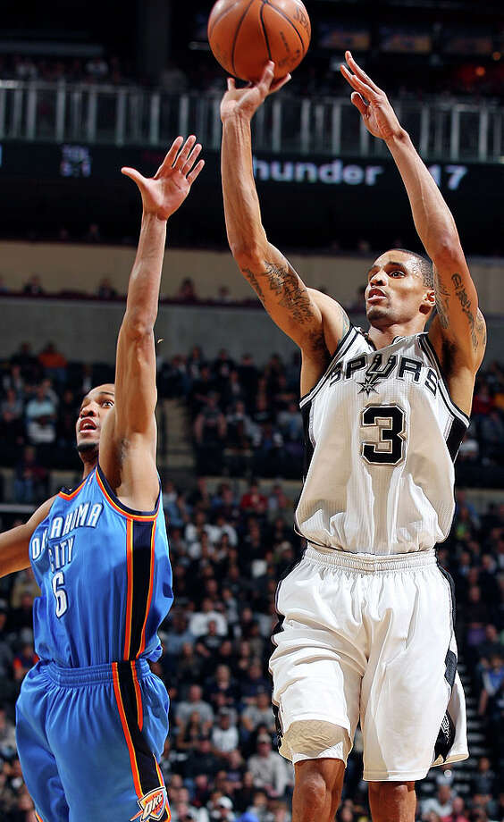 Spurs' George Hill shoots around  Thunder's Eric Maynor during first half action Saturday. Photo: EDWARD A. ORNELAS/eaornelas@express-news.net