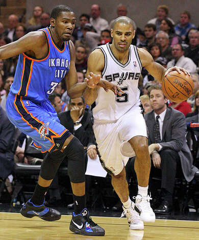 Spurs' Ime Udoka looks for room around  Thunder's Kevin Durant during second half action Saturday. Photo: EDWARD A. ORNELAS/eaornelas@express-news.net