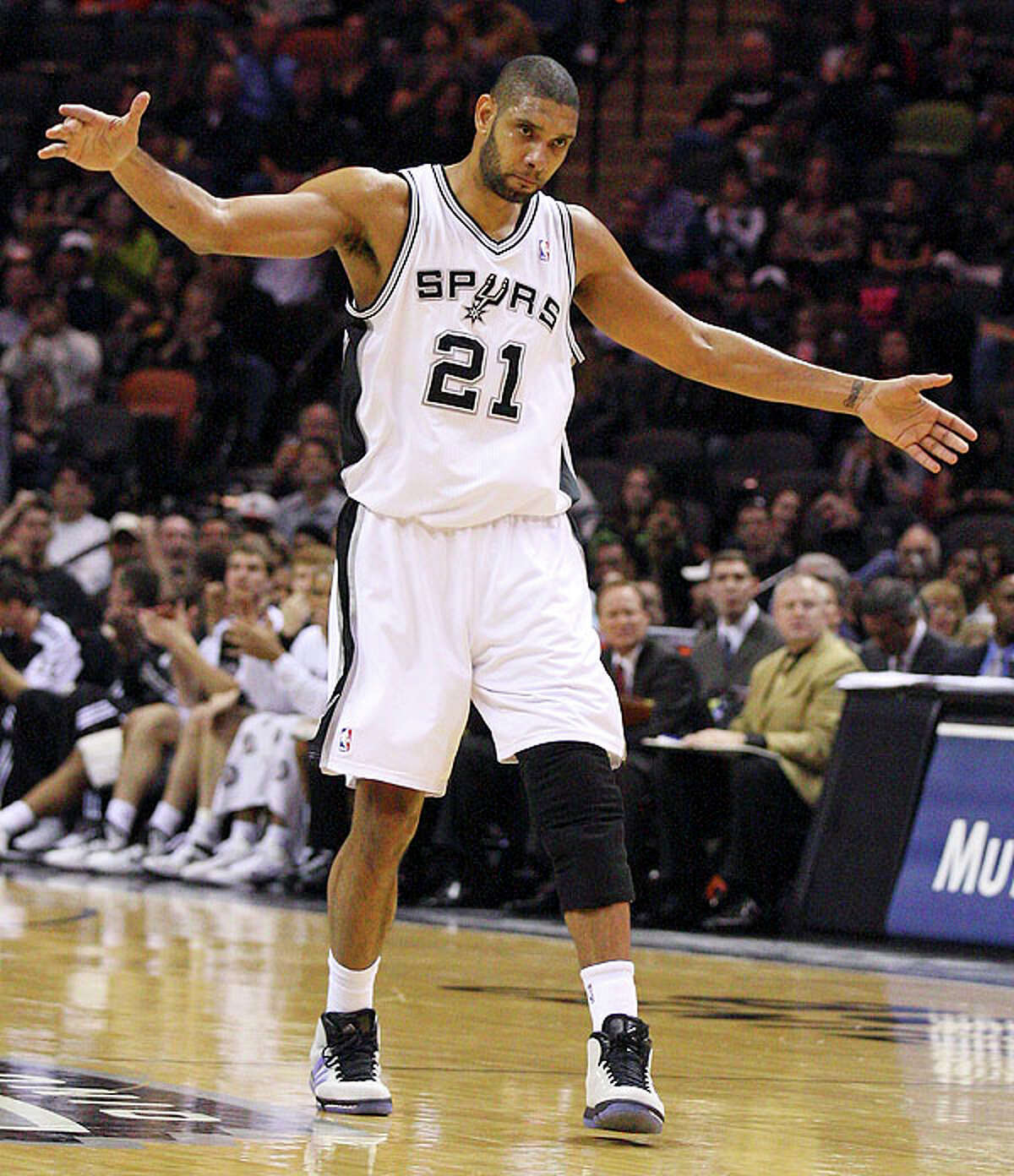 Spurs' Tim Duncan  reacts after scoring against the Thunder during second half action Saturday.