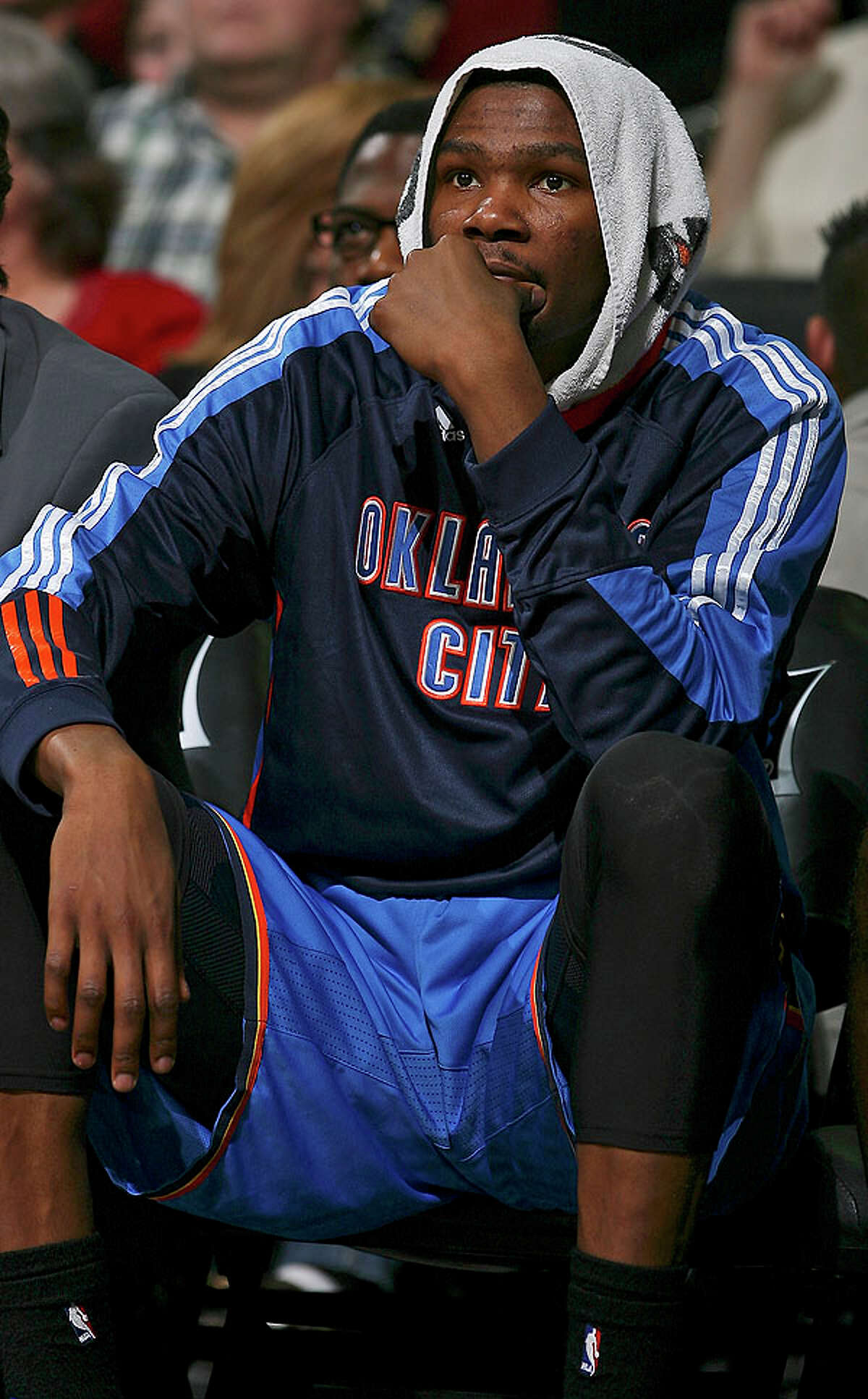 Thunder's Kevin Durant sits dejected on the bench against the Spurs during second half action Saturday.