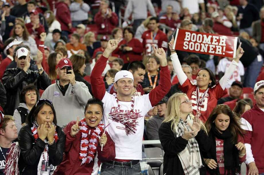 GLENDALE, AZ - JANUARY 01:  Oklahoma Sooners fans cheer late in the fourth quarter while taking on the Connecticut Huskies during the Tostitos Fiesta Bowl at the Universtity of Phoenix Stadium on January 1, 2011 in Glendale, Arizona.  (Photo by Christian Petersen/Getty Images) Photo: Christian Petersen, Getty Images / 2011 Getty Images