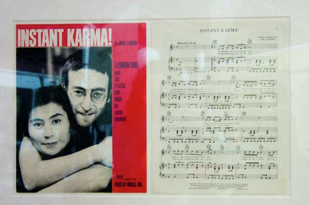 "John Lennon's ""Instant Karma"" music sheet on auction during the Braswell Galleries' 24th Annual New Year's Day Auction in Norwalk, Conn., Saturday, January 1, 2011. More than 700 items were on the block including John Lennon's white Abbey Road suit, Imagine jacket and 1972 Chrysler station wagon, which sold for $46,000, $18,000 and $55,000 respectively. Artwork by Pablo Picasso and Damien Hirst also sold. Photo: Keelin Daly / Stamford Advocate"
