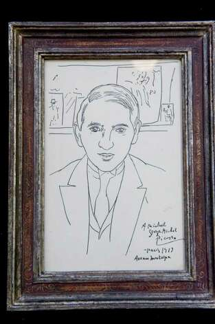 Pablo Picasso's portrait of Michel Georges-Michel dated 1919 fetched  $11,000 during the Braswell Galleries' 24th Annual New Year's Day Auction in Norwalk, Conn., Saturday, January 1, 2011. More than 700 items were on the block including John Lennon's white Abbey Road suit, Imagine jacket and 1972 Chrysler station wagon, which sold for $46,000, $18,000 and $55,000 respectively. Artwork by Damien Hirst also sold. Photo: Keelin Daly / Stamford Advocate