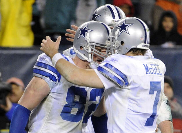 Dallas Cowboys tight end Jason Witten (left) celebrates his touchdown reception with quarterback Stephen McGee. The Cowboys won 14-13 to finish the season 6-10, but were 5-3 under interim coach Jason Garrett. Photo: Miles Kennedy/Associated Press