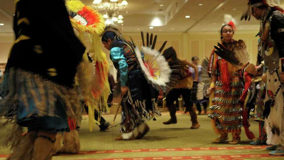 Members of the Silver Hawk Singers, a Native American drum group comprised of different tribes from New England, perform  during the Rock, Rattle and Drum Pow Wow at the Crowne Plaza in Albany on Sunday, Jan. 2, 2011.  The three-day event brought authentic Native American dancing and drumming, arts and crafts and demonstrations.  A portion of the proceeds will benefit the Albany Boys and Girls Club and Stride - Adaptive Sports, a not-for-profit veterans organization based in Clifton Park, Warriors in a New Age, an at-risk youth program and LarkTV, a youth media literacy project.  (Paul Buckowski / Times Union) Photo: Paul Buckowski / 00011552A