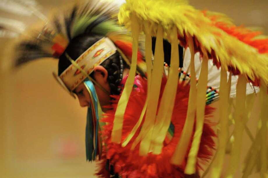 Sherman Addi, 12 years old, a Kiowa Indian from Oklahoma, performs   during the Rock, Rattle and Drum Pow Wow at the Crowne Plaza in Albany on Sunday, Jan. 2, 2011. Photo: Paul Buckowski / 00011552A