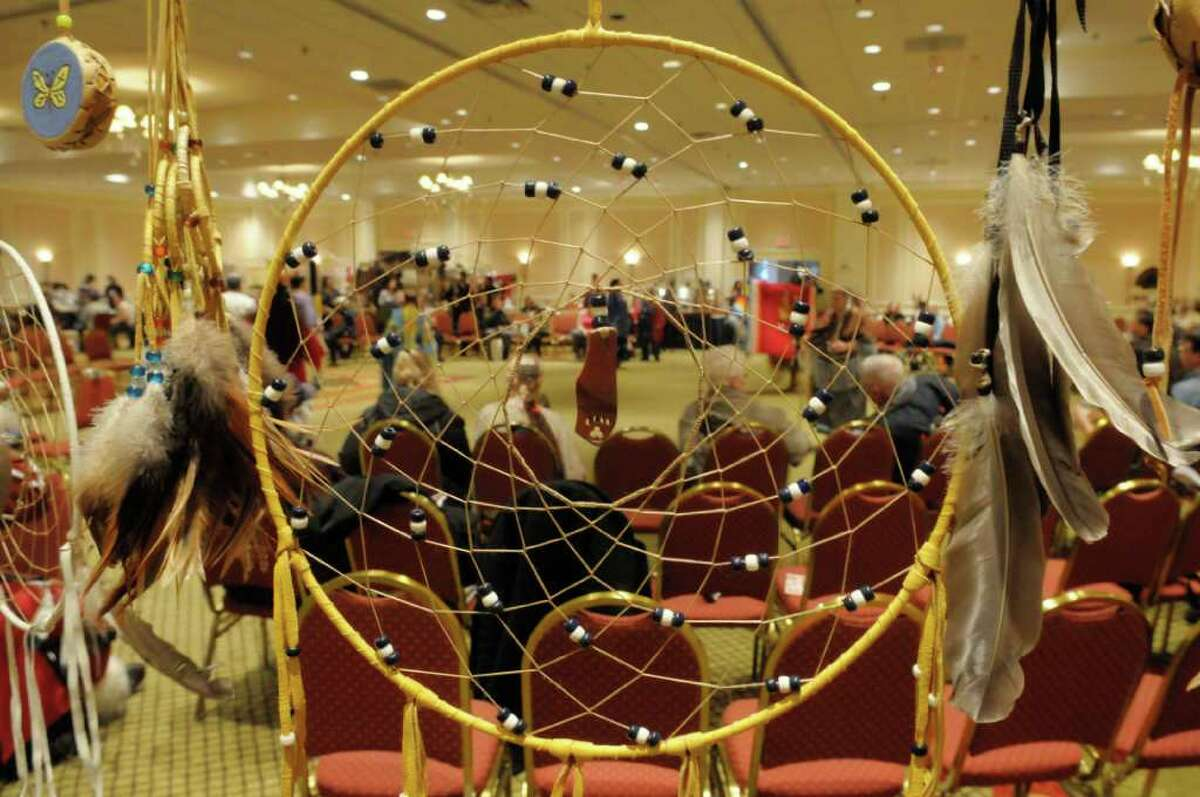 A dream catcher woven by Cayuga Indian Ashley Greene with a sacred pipestone carving by her father, David Greene out of Altamont, NY, is seen on display for sale during the Rock, Rattle and Drum Pow Wow at the Crowne Plaza in Albany on Sunday, Jan. 2, 2011. (PAUL BUCKOWSKI/Times Union)