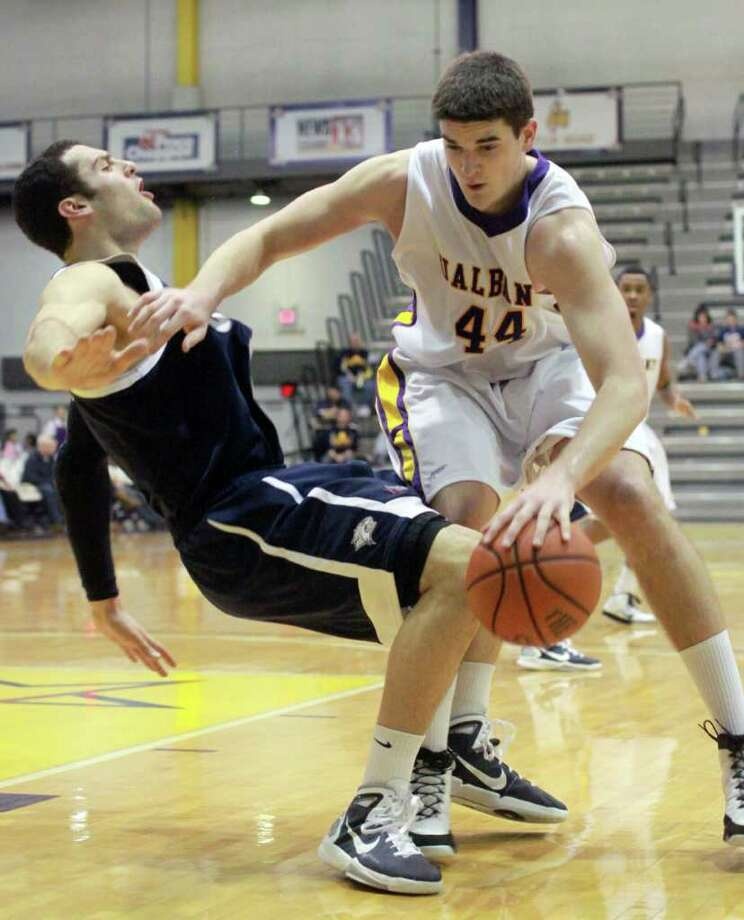 The University at Albany's John Puk (44) fouls New Hampshire's Dane DiLiegro during Sunday afternoon's men's basketball game at SEFCU Arena in Albany. UAlbany won 59-44 in its America East Conference opener. (Patrick Dodson / Special to the Times Union) Photo: Patrick Dodson / 00011574A