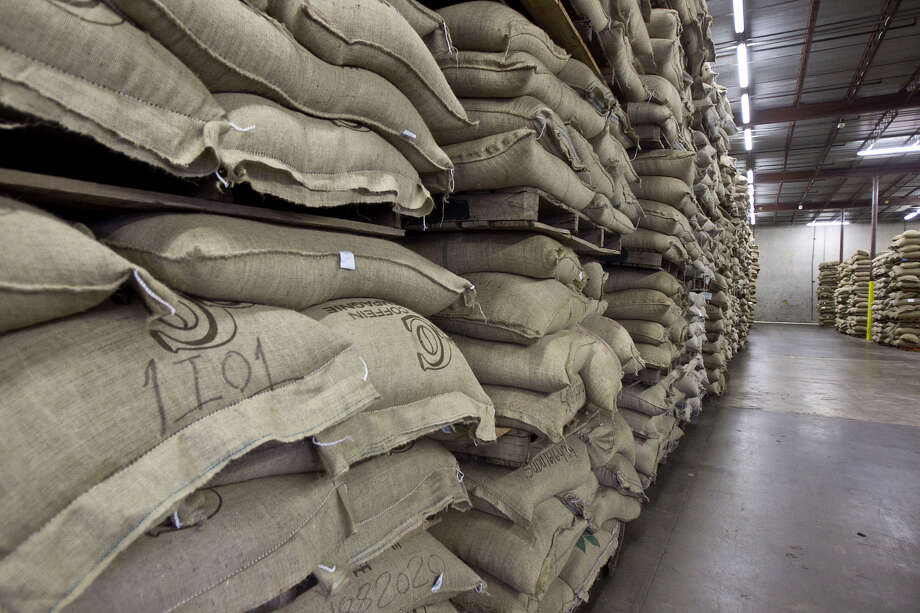 Pallets of coffee bags sit in a warehouse at Gulf Winds International, Inc. A statewide inventory tax exemption has helped the Houston company prosper. But the next legislature may consider repealing the amendment to help replenish its coffers. Photo: James Nielsen/jamesnielsen@chron.com